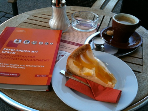 Textbook, coffe and cake